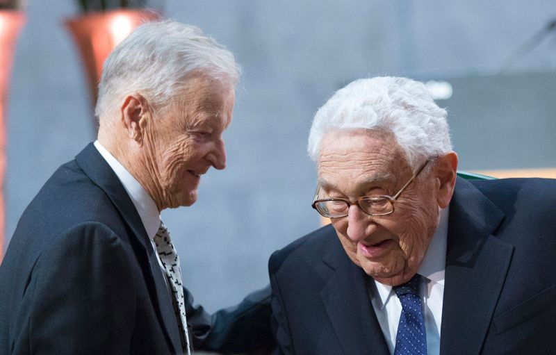 Former U.S. National Security Advisor Zbigniew Brzezinski and former U.S. Secretary of State Henry Kissinger