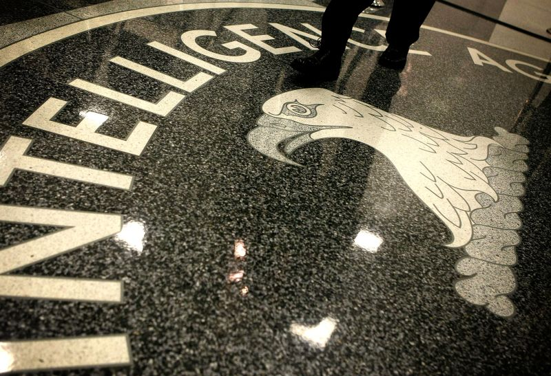 A man walks across the seal of the CIA at the lobby at CIA headquarters in McLean, Virginia, on Feb. 19, 2009.