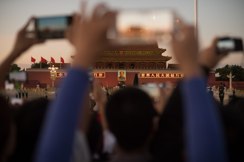The lowering of the Chinese flag on Tiananmen Square in Beijing
