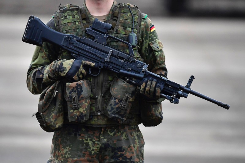 A German soldier holds a machine gun during military exercises near Bergen, Germany, on Oct. 14, 2016.