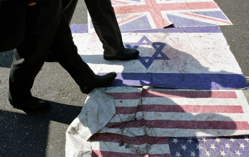 Iranians step on the U.S., Israeli, and British flags during a parade marking al-Quds International Day in Tehran on May 31, 2019.
