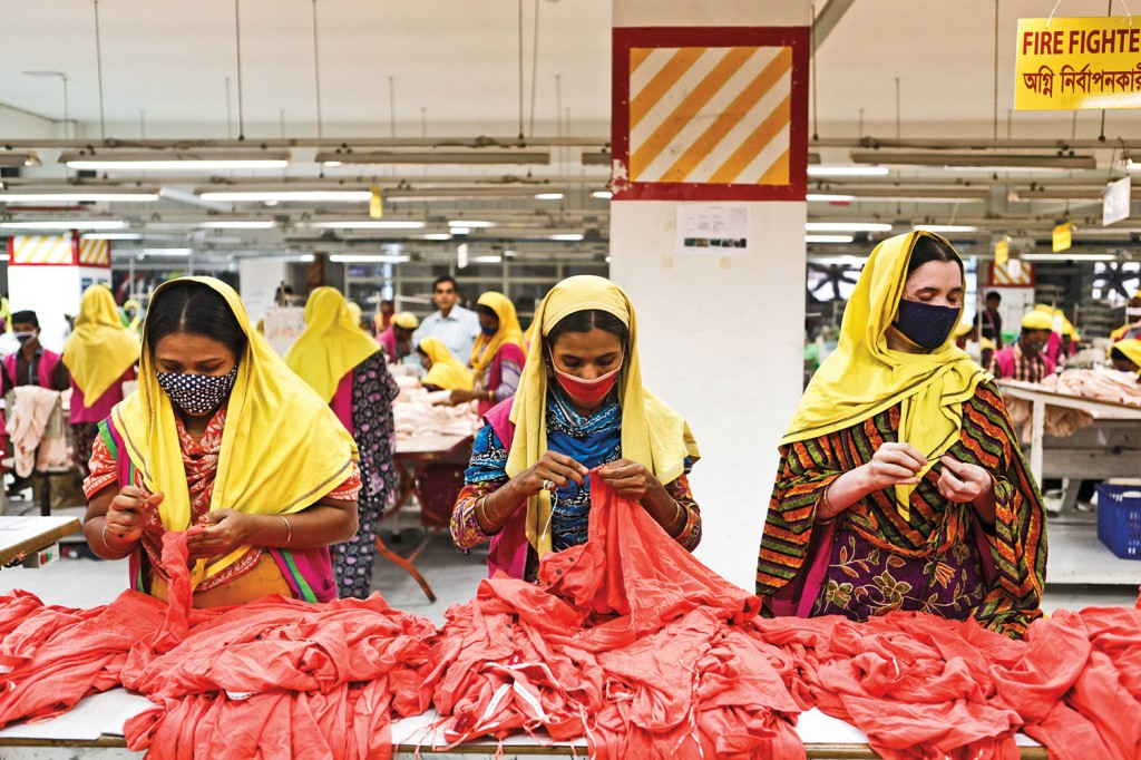 A team of dressmakers works in a factory in Dhaka, Bangladesh, on Nov. 22, 2012.