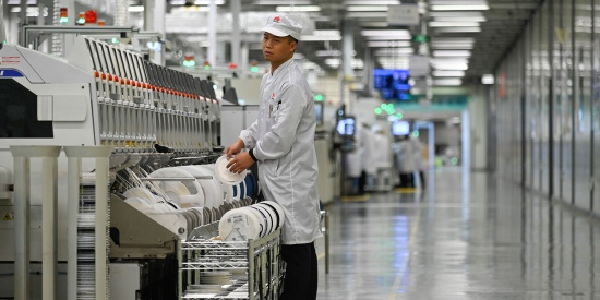 An employee works at a Huawei mobile phone production line during a media tour in Dongguan, China, on March 6, 2019. Chinese telecom giant Huawei gave foreign media a peek into its state-of-the-art facilities as the normally secretive company stepped up a counteroffensive against U.S. warnings that it could be used by Beijing for espionage and sabotage.
