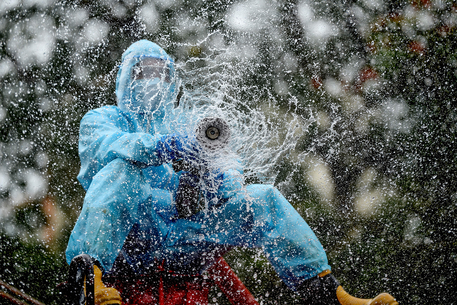 A firefighter sprays disinfectant in a containment zone in Chennai, India, on June 11. ARUN SANKAR/AFP via Getty Images