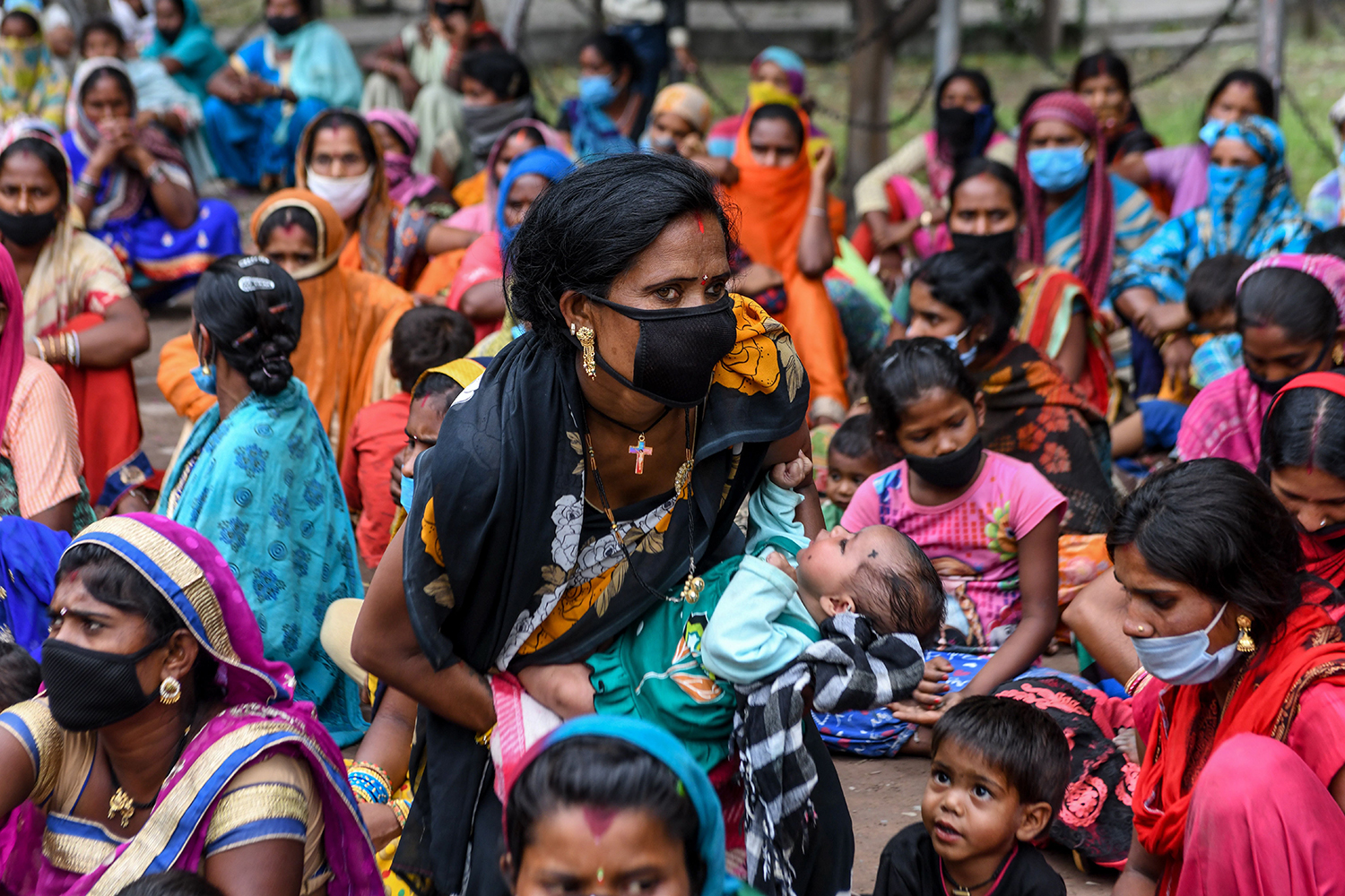 Migrant laborers and their families from Chhattisgarh, India, protest against the government to demand their return home June 3. NARINDER NANU/AFP via Getty Images