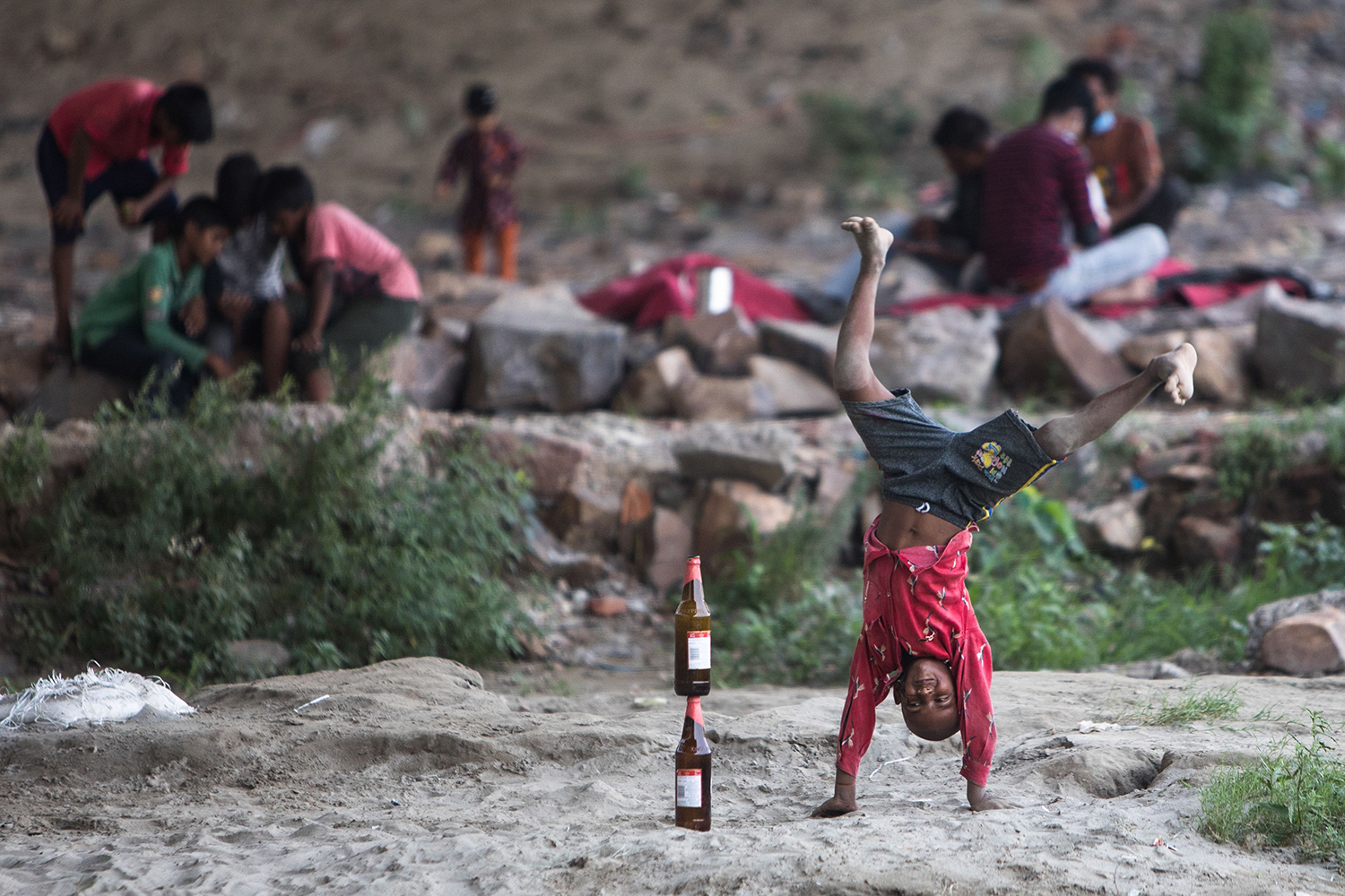 A boy plays under a bridge along the banks of the Yamuna River as temperatures rise in New Delhi on June 18. XAVIER GALIANA/AFP via Getty Images