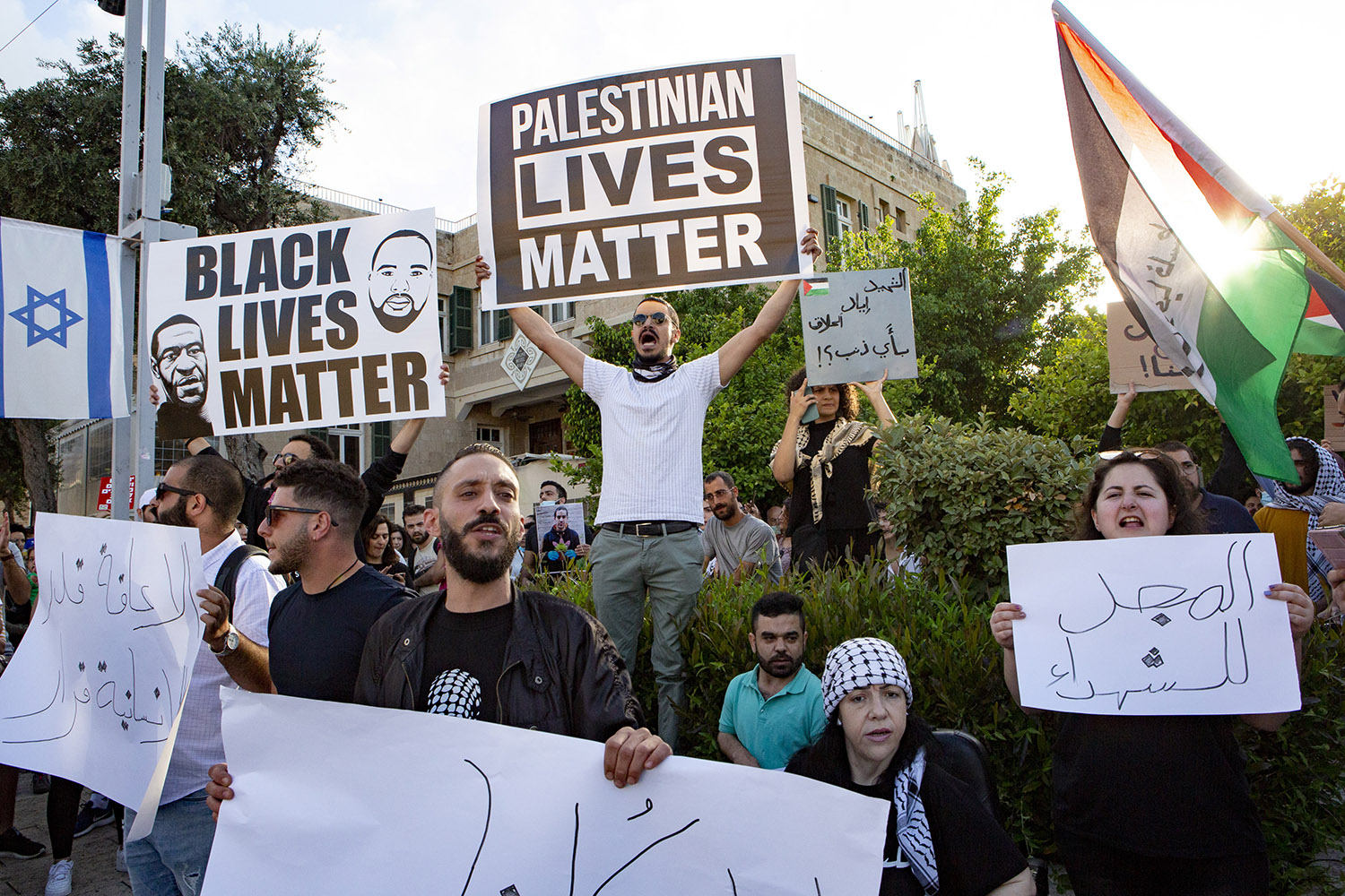 Hundreds of Palestinian citizens of Israel protest in the city of Haifa, Israel, on June 2 against the Israeli police killing of an unarmed autistic Palestinian man just days earlier, tying the incident to the police killing of George Floyd in the United States.