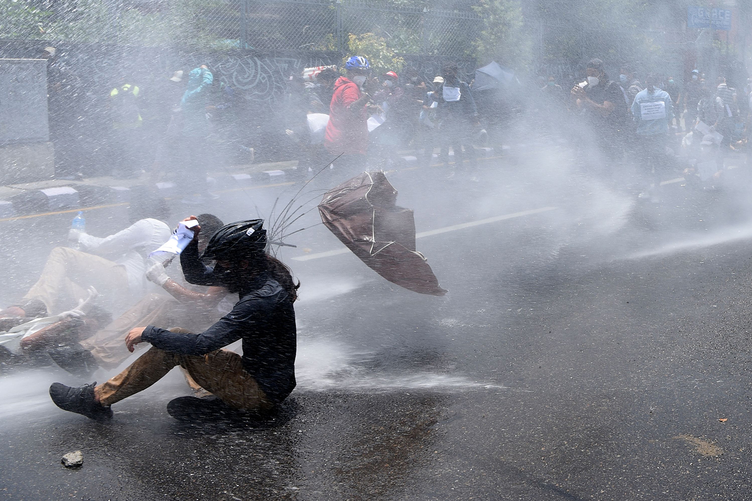 Police use a water cannon to disperse demonstrators protesting against the government's coronavirus policies in Kathmandu, Nepal, on June 9. PRAKASH MATHEMA/AFP via Getty Images
