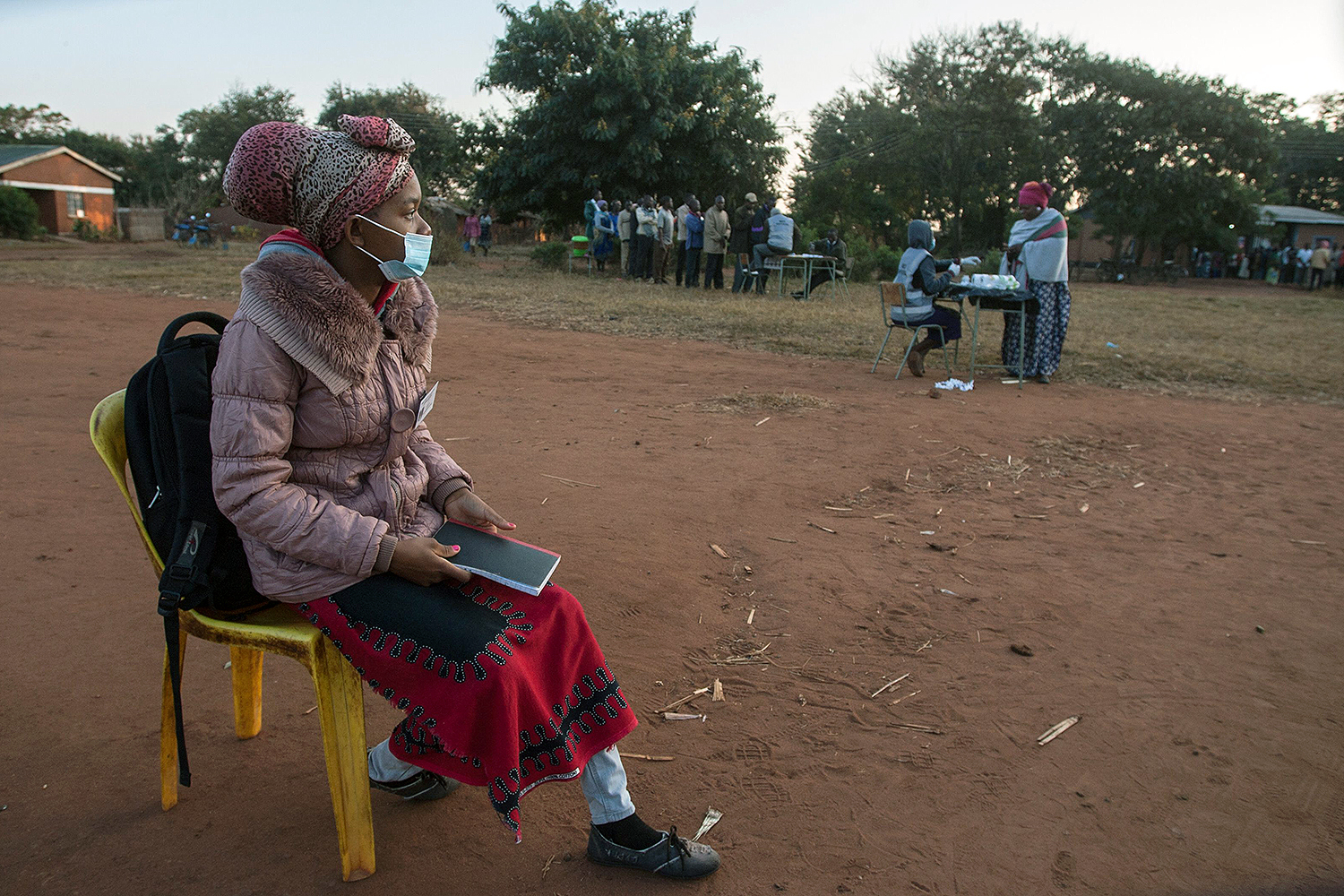 An elections party monitor watches over queues of voters during the Malawi presidential elections in Lilongwe on June 23. AMOS GUMULIRA/AFP via Getty Images