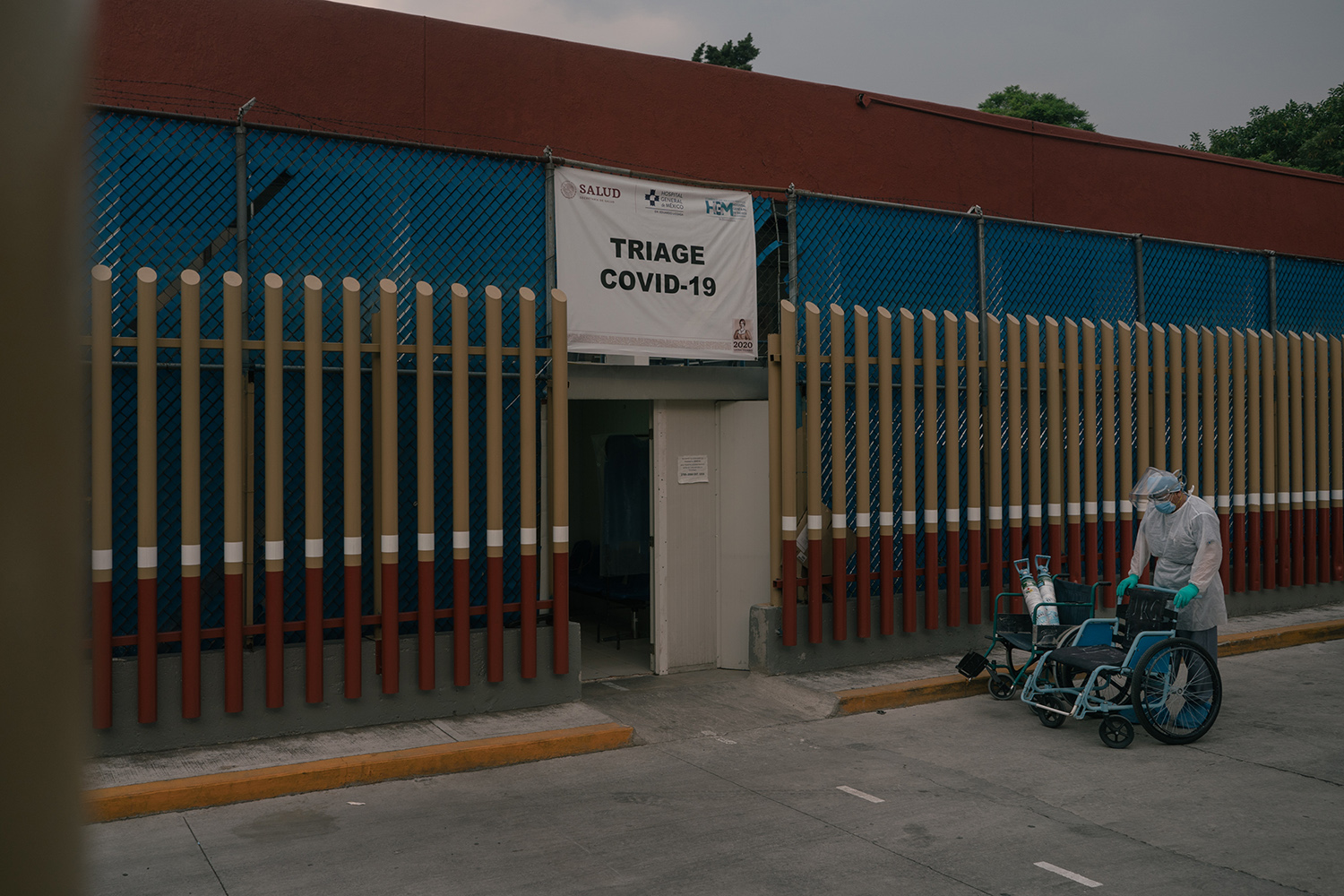 A hospital worker waits outside a COVID-19 triage unit at the General Hospital of Mexico in Mexico City on May 21.