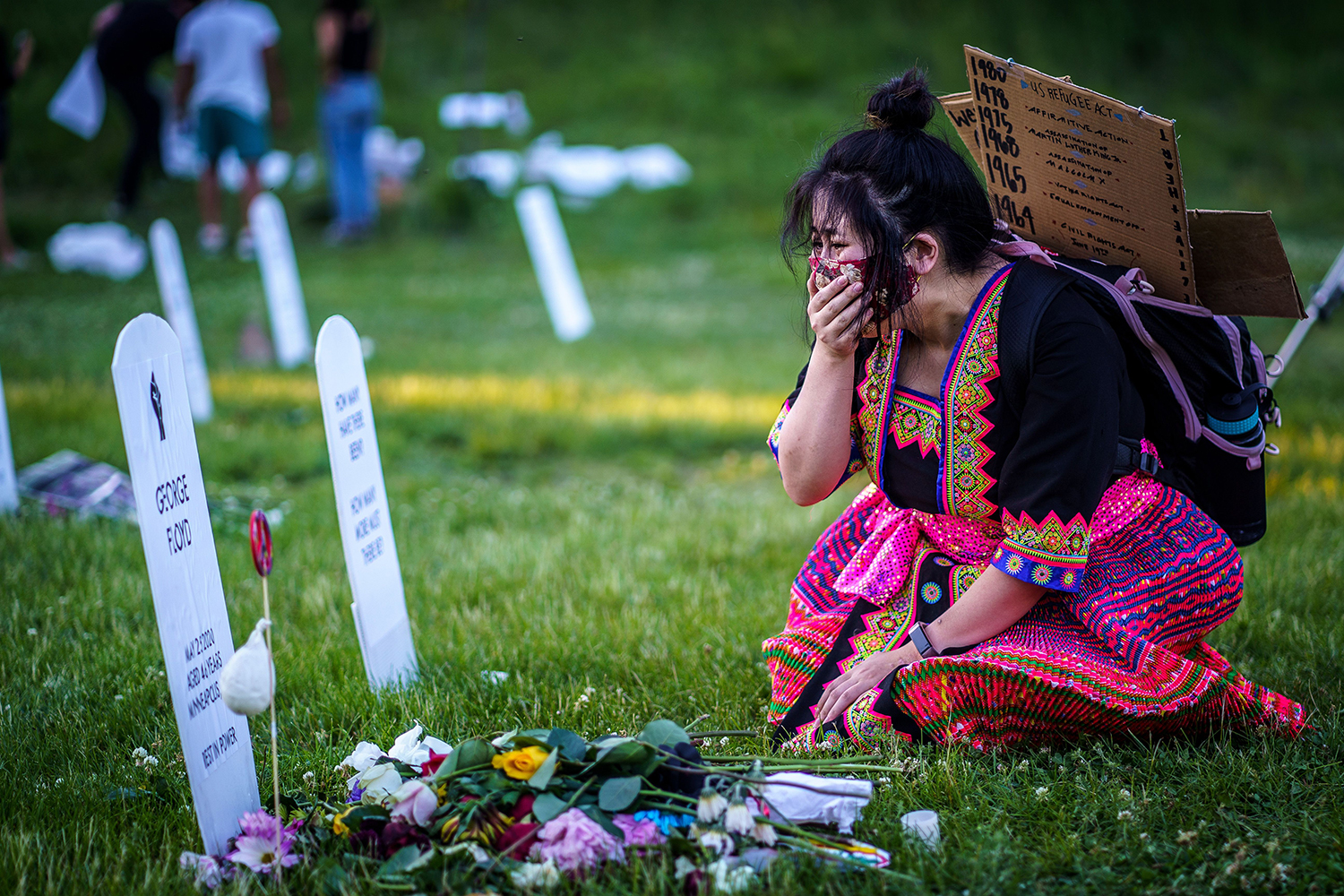 """Abby James, 32, cries in front of an installation called """"Say Their Names"""" in Minneapolis on June 7 in honor of victims of police brutality. KEREM YUCEL/AFP via Getty Images"""