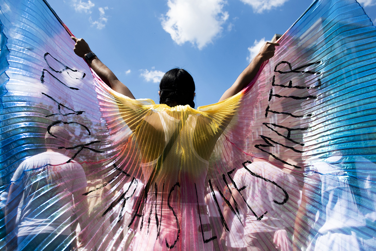 """A protester displays """"Black Trans Lives Matter"""" wings while marching in the Brooklyn borough of New York City on June 14. Protests have continued all across the country and around the world following the death of George Floyd at the hands of Minneapolis police last month. Michael Noble Jr./Getty Images"""