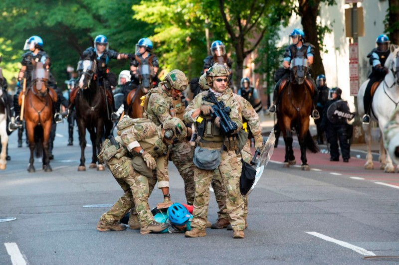 Members of U.S. Marshal Special Operations restrain a protestor near the White House on June 1, 2020 in Washington D.C., as demonstrations against George Floyd's death continue.