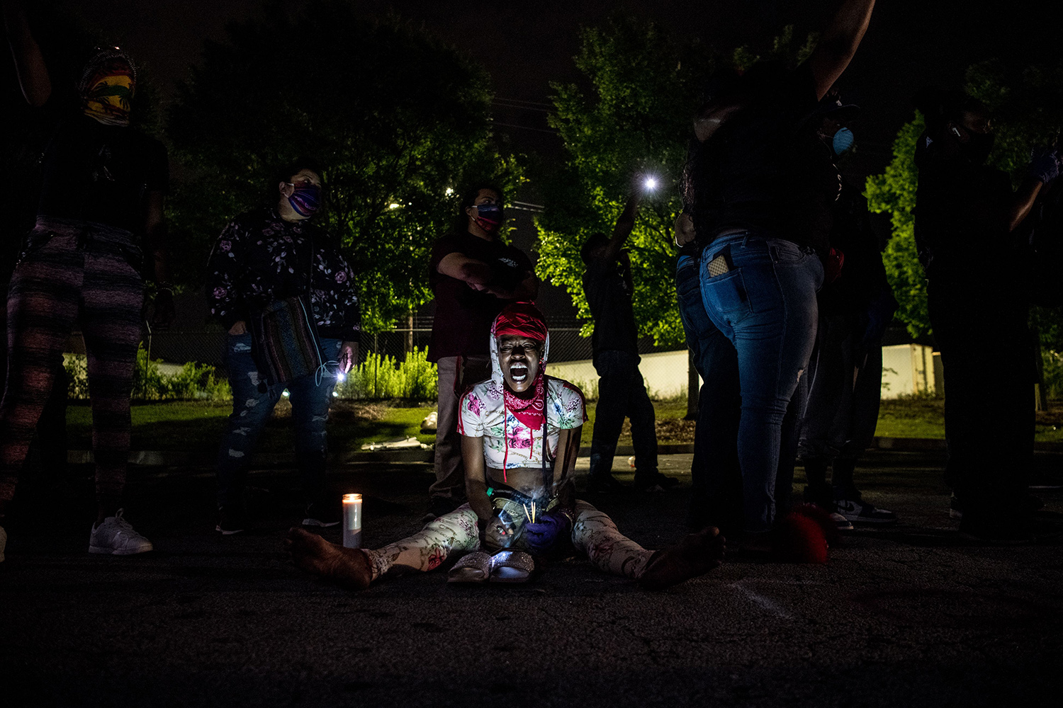 A woman shouts in Atlanta on June 15 as she protests outside a burned Wendy's restaurant following the police shooting death of Rayshard Brooks in the restaurant parking lot three days earlier. CHANDAN KHANNA/AFP via Getty Images