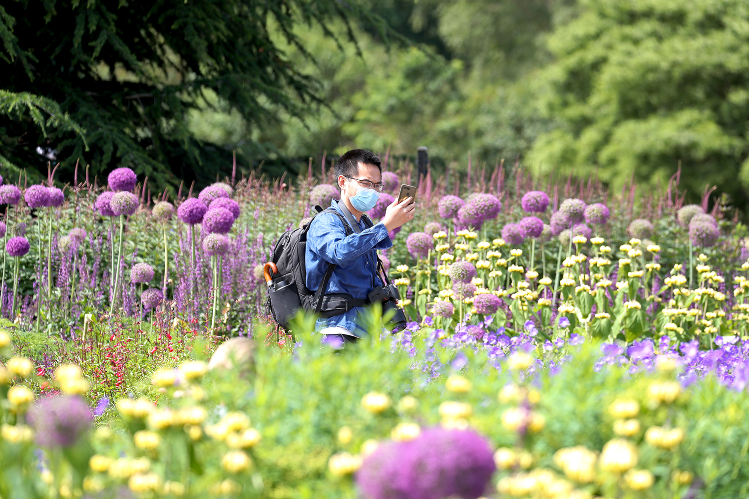 A visitor takes a selfie at the Royal Botanic Gardens at Kew in London on June 9. Chris Jackson/Getty Images