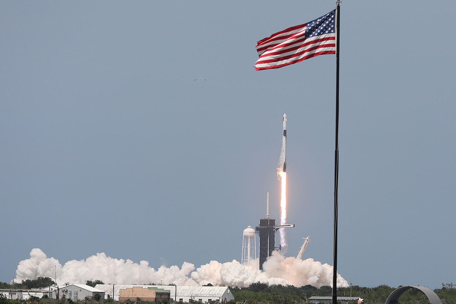 A SpaceX Falcon 9 rocket carrying the Crew Dragon spacecraft lifts off at Kennedy Space Center in Florida on May 30. GREGG NEWTON/AFP via Getty Images