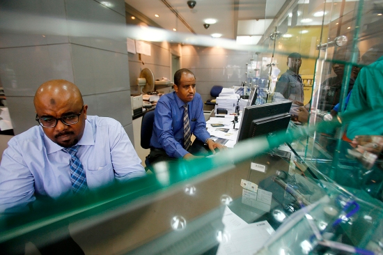 Dealers work at a foreign exchange office in Khartoum on Oct. 12, 2017, after the United States lifted its trade embargo. Sudan suffered a deep shock after re-entering the global economy following the removal of sanctions.