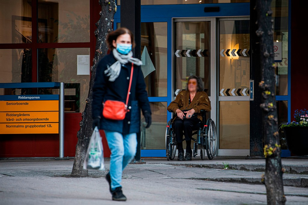 A woman sits outside her nursing home in Stockholm on May 4. Sweden, whose softer approach to the coronavirus has garnered international attention, admits it has failed to adequately protect the elderly, with around half of its COVID-19 deaths occurring among nursing home residents. JONATHAN NACKSTRAND/AFP via Getty Images