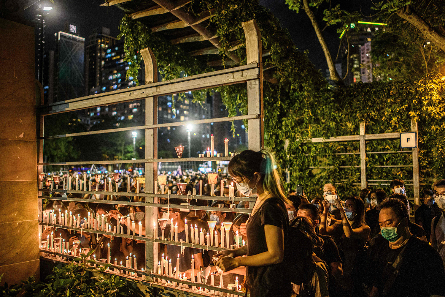 People light candles as they attend a vigil in Victoria Park in Hong Kong on June 4 marking the anniversary of China's deadly Tiananmen Square crackdown, defying a ban against gathering as tensions seethed over a planned new security law. ANTHONY WALLACE/AFP via Getty Images
