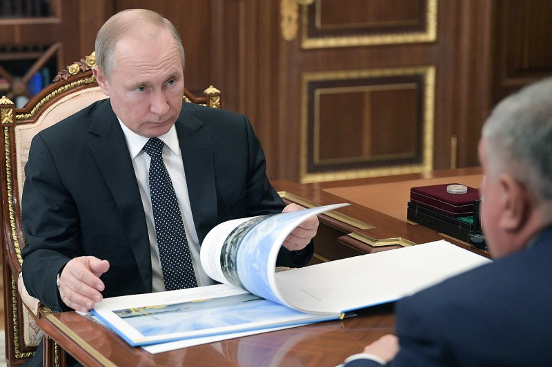 Russian President Vladimir Putin listens to Igor Sechin during a meeting at the Kremlin in Moscow on April 1, 2019. Among the powerful businessmen and officials with whom Putin surrounds himself is Sechin, a former KGB agent in East Africa who worked as Putin's secretary in the 1990s and is now the head of state-owned oil giant Rosneft. ALEXEI DRUZHININ/AFP via Getty Images