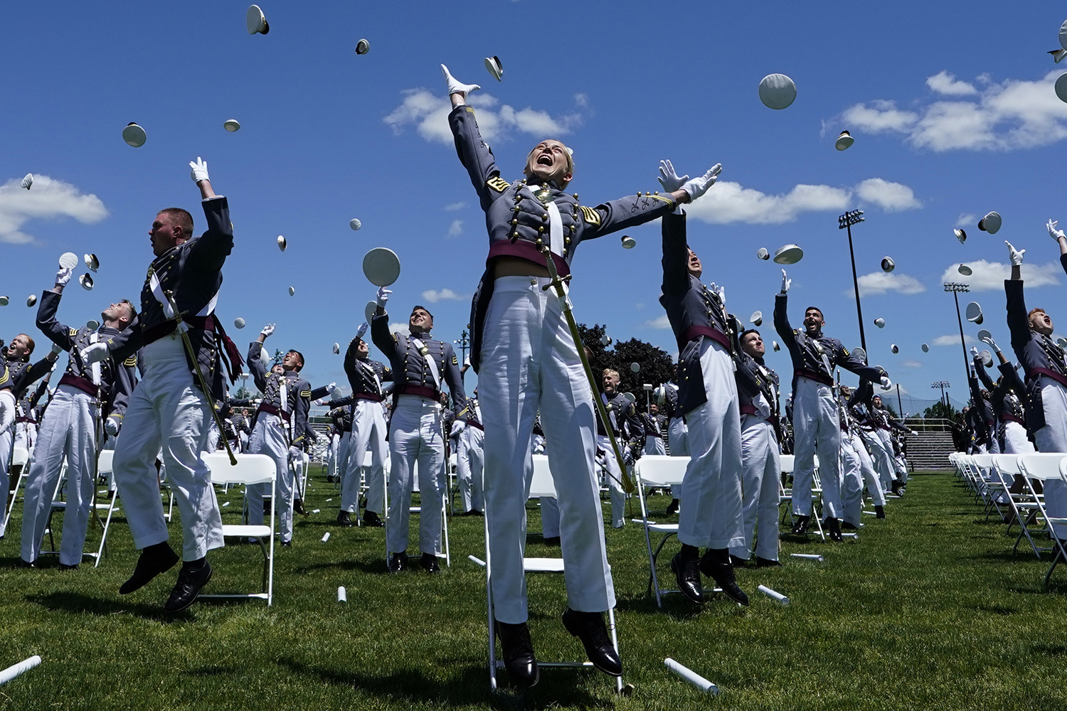 U.S. Military Academy cadets toss their hats at the end of a graduation ceremony in West Point, New York, on June 13. TIMOTHY A. CLARY/AFP via Getty Images