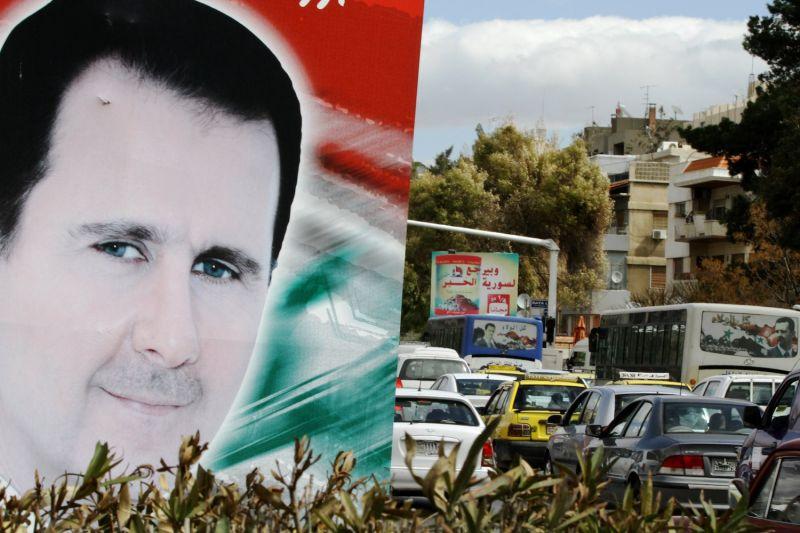 A banner bearing a portrait of Syrian President Bashar al-Assad.