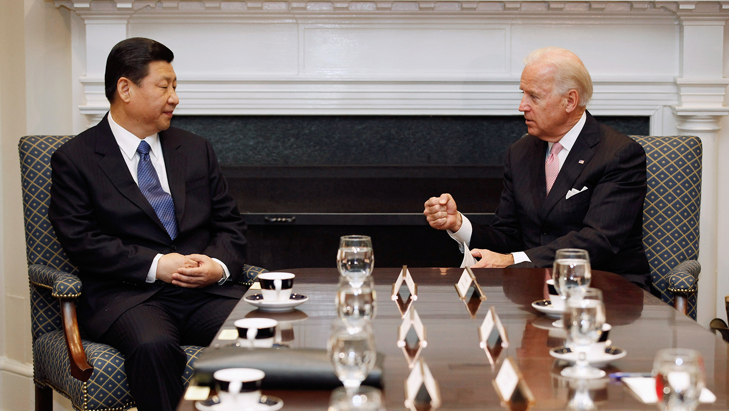 Biden and then-Chinese Vice President Xi Jinping talk during an expanded bilateral meeting with other U.S. and Chinese officials at the White House in Washington on Feb. 14, 2012.
