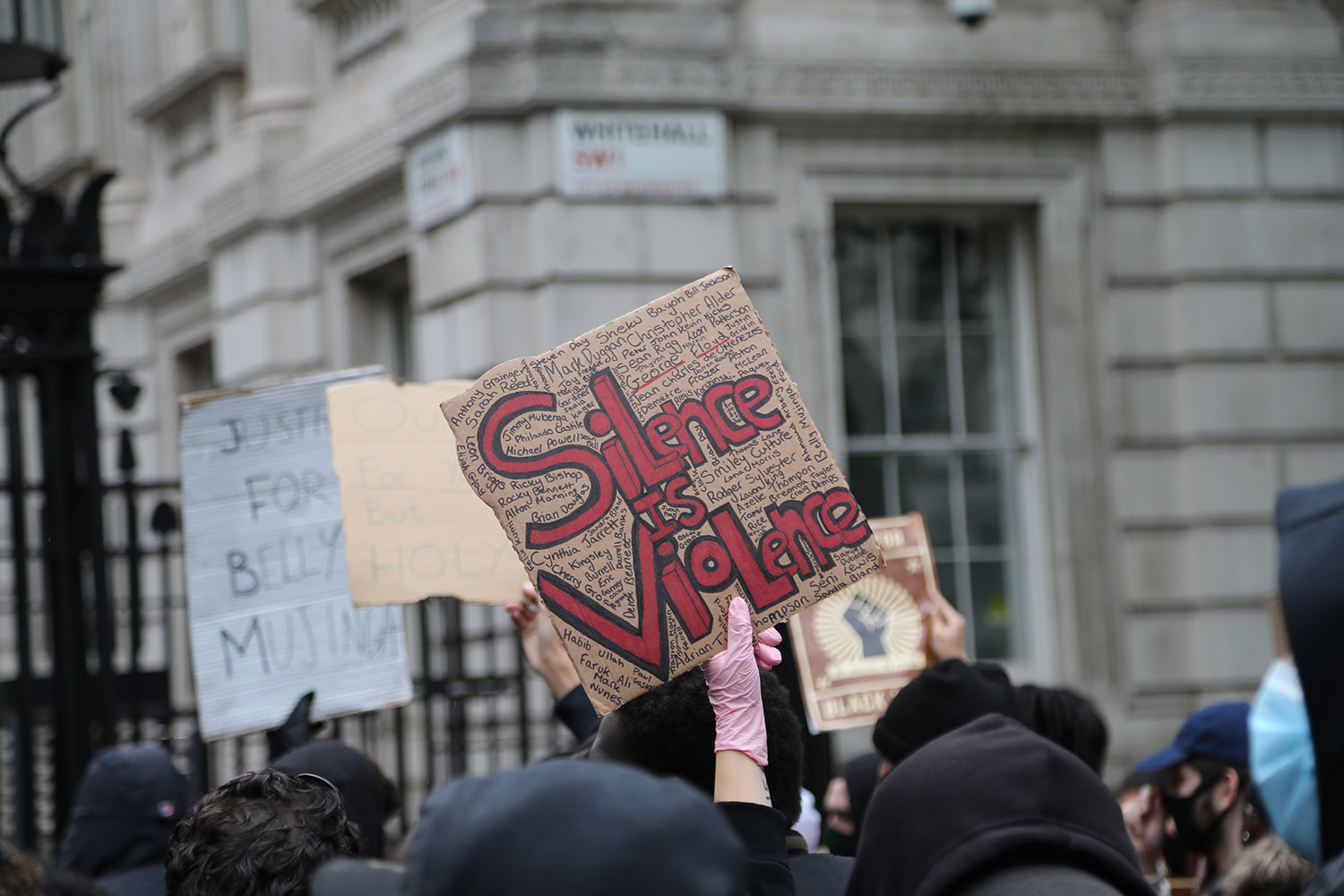 A demonstrator holds a banner reading during a protest in solidarity with U.S. anti-racism demonstrations outside Downing Street in London on June 7.