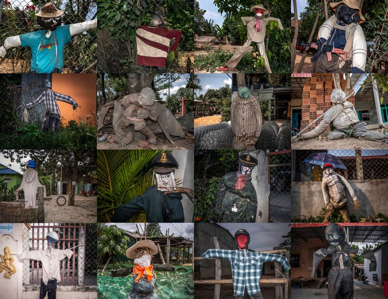 Scarecrows known as ting mong stand guard in front of homes in Takeo, Kandal, and Kampong Speu provinces in Cambodia to ward off the coronavirus in May.