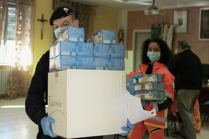 A Carabiniere policeman helps with deliveries of face masks in Palagano, Italy on April 9, during the country's lockdown aimed at stopping the spread of the COVID-19 pandemic.