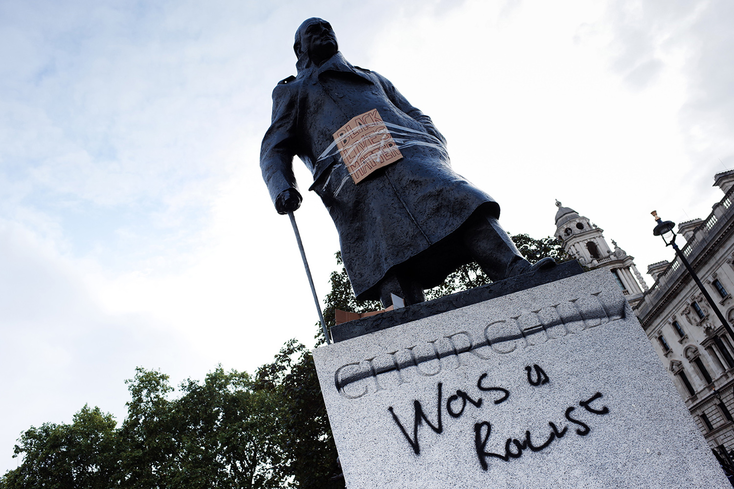 The Parliament Square statue of Britain's wartime leader Winston Churchill stands defaced as activists gather in mass protest against racism in London on June 7.