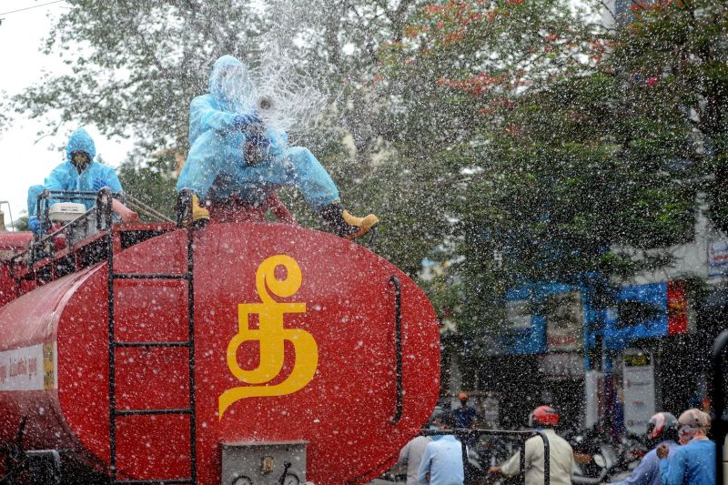 A firefighter sprays disinfectant as a preventive measure against the spread of the COVID-19 coronavirus in a containment zone in Chennai on May 11, 2020.