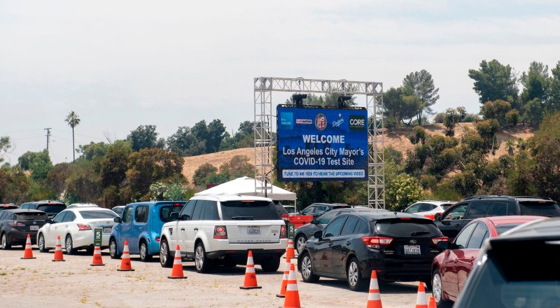 Cars wait in line at a Covid-19 testing center at Dodger Stadium, June 25, 2020, in Los Angeles, California.