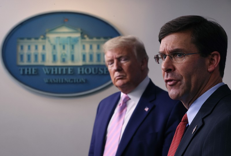 U.S. Secretary of Defense Mark Esper speaks as President Donald Trump listens during the daily White House coronavirus press briefing on April 1 in Washington.