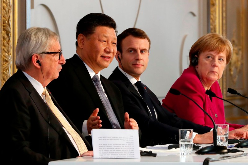 (From L) European Commission President Jean-Claude Juncker, Chinese President Xi Jinping, French President Emmanuel Macron and German Chancellor Angela Merkel hold a press conference in Paris on March 26, 2019.