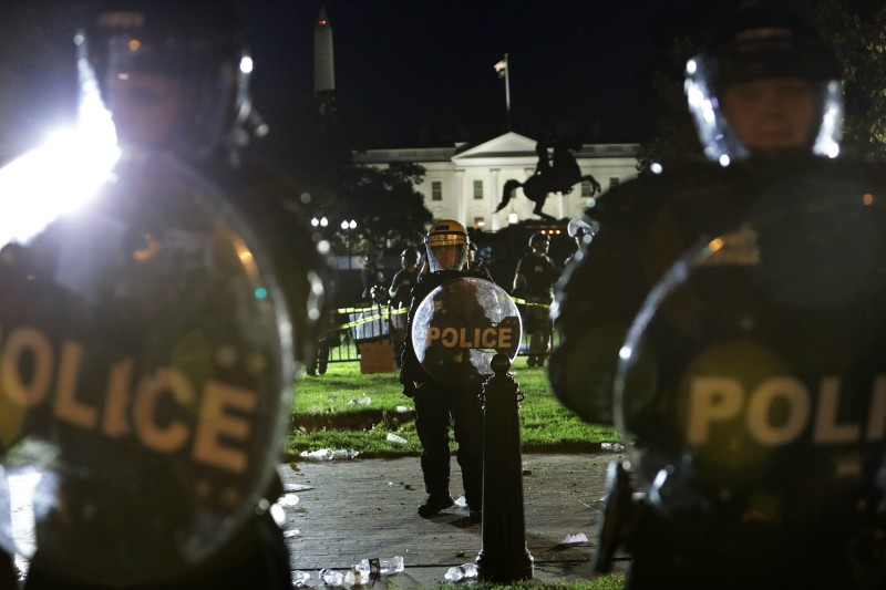 Members of the U.S. Secret Service hold a perimeter near the White House as demonstrators gather to protest the killing of George Floyd on May 30, 2020 in Washington, DC.