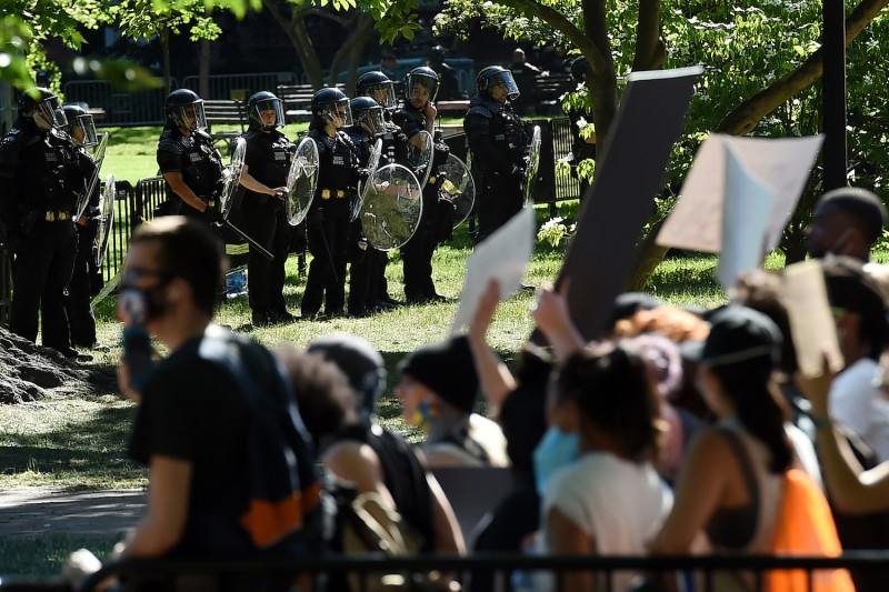 U.S. Park Police stand watch inside Lafayette Square near the White House in Washington, DC on June 1 as demonstrators protest the death of George Floyd.