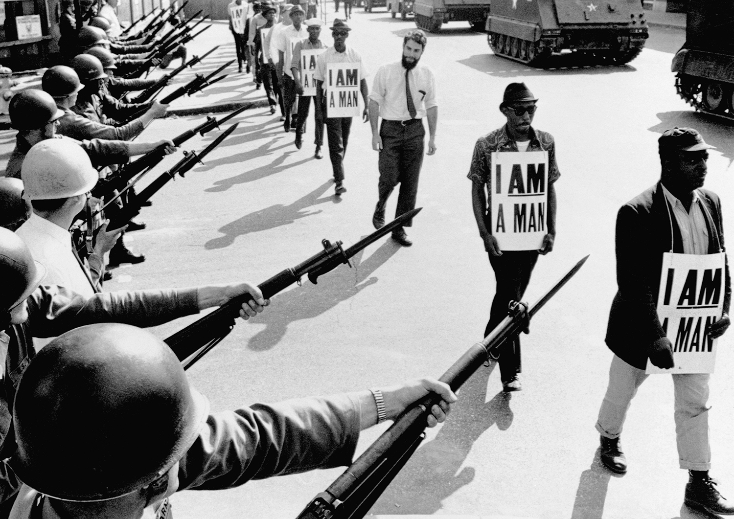 """Civil Rights activists carrying """"I Am a Man"""" placards are blocked by National Guardsmen during a protest in Memphis, Tennessee, in 1968."""