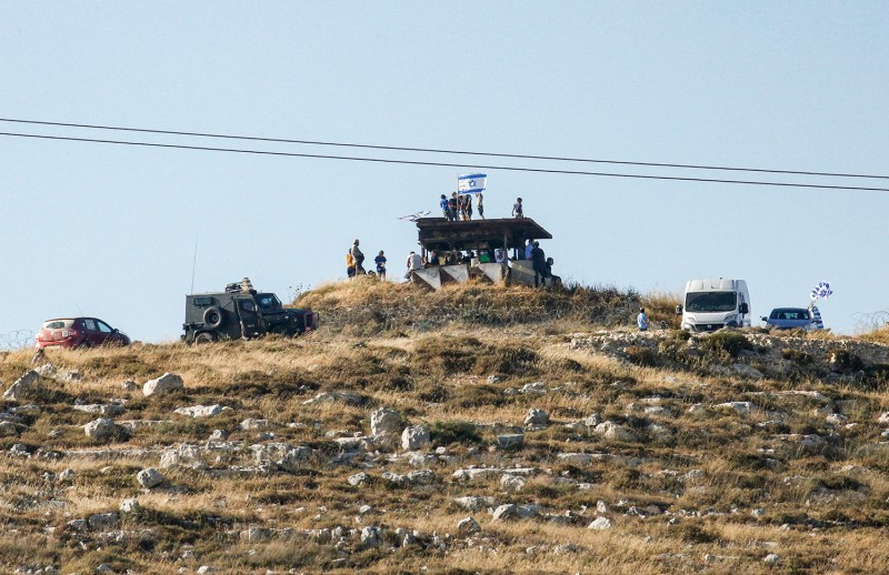 Israeli settlers gather on a hill next to the Palestinian town of Halhul, in the occupied West Bank, on June 30 as they attend a rally against U.S. President Donald Trump's peace plan.