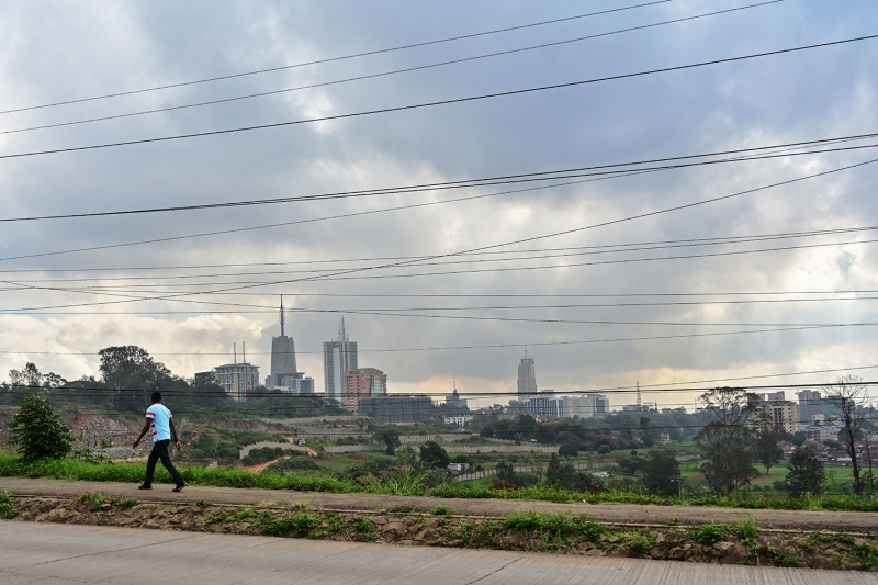 Nairobi, Kenya, which has seen rapid economic expansion in recent years, is seen through a crisscross of electrical lines on May 16, 2019.