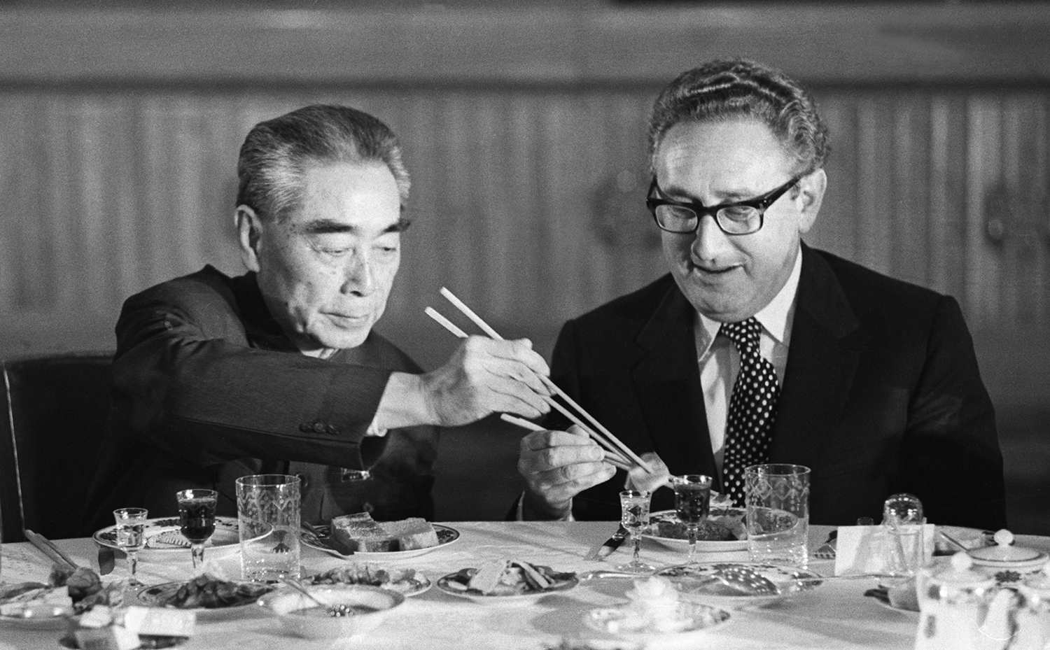 Kissinger accepts food from Chinese Premier Zhou Enlai during a state banquet in the Great Hall of the People in Beijing on Nov. 10, 1973.