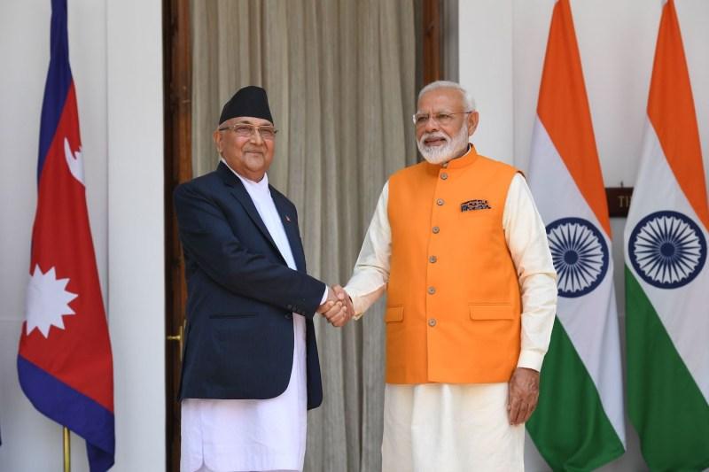 Indian Prime Minister Narendra Modi shakes hands Nepal Prime Minister KP Sharma.