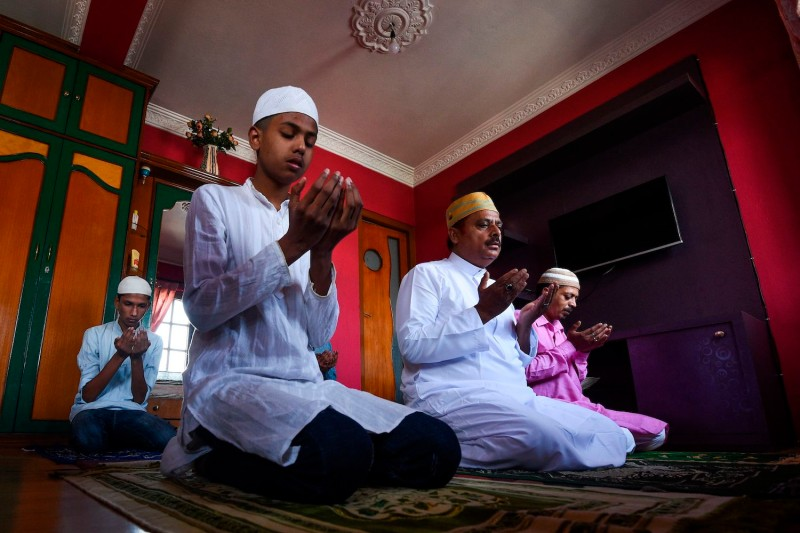 A Muslim family offers a special prayer in their home during the Eid-al-Fitr festival.