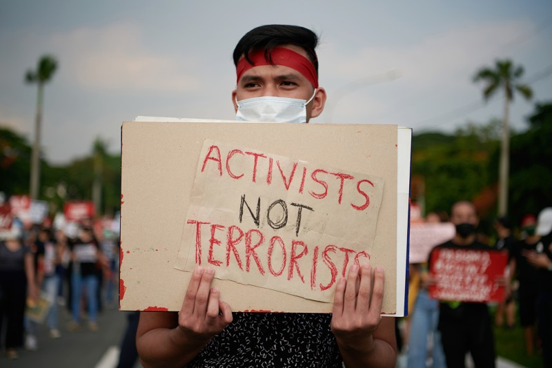 Filipino protesters in protective masks march in protest over the government's new anti-terror law on June 4 in Quezon City, Philippines.