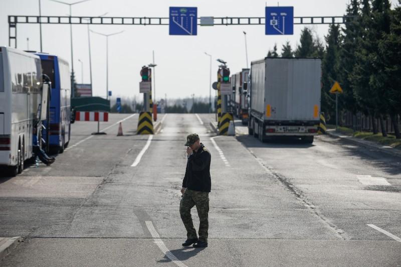 A guard patrols Poland's border with Ukraine.