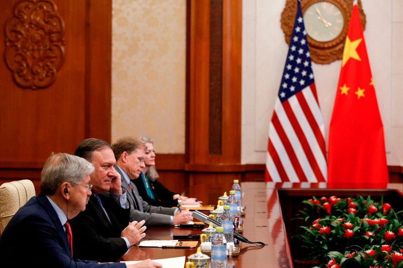 U.S. Secretary of State Mike Pompeo listens to Yang Jiechi, a member of the Political Bureau of the Chinese Communist Party, during a meeting at the Diaoyutai State Guesthouse in Beijing on October 8, 2018.