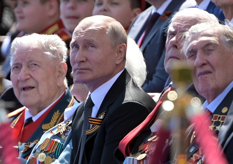 Russian President Vladimir Putin watches a military parade marking the 75th anniversary of the victory in World War II, on on Red Square on June 24 in Moscow.