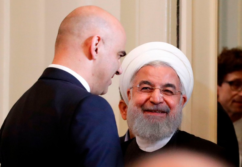 Iranian President Hassan Rouhani and Swiss President Alain Berset attend a joint press conference.