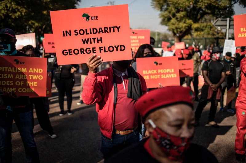 Economic Freedom Fighters supporters gather in front of the U.S. Embassy in Pretoria, on June 8 in solidarity with the global Black Lives Matter movement.