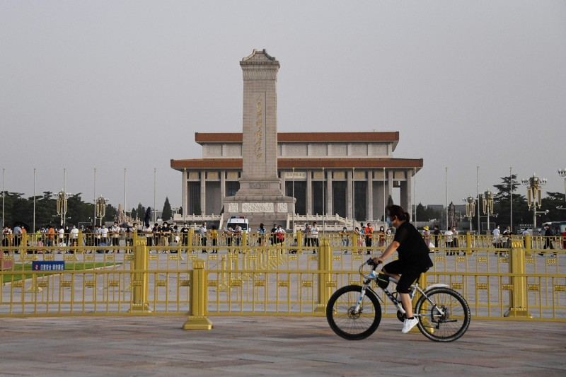 A man cycles past Tiananmen Square in Beijing on the eve of the 31st anniversary of the June 4, 1989, crackdown on pro-democracy protests on June 3.
